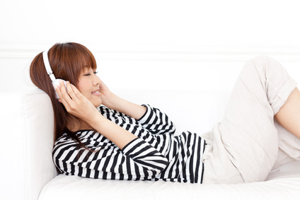 attractive asian woman listening to music